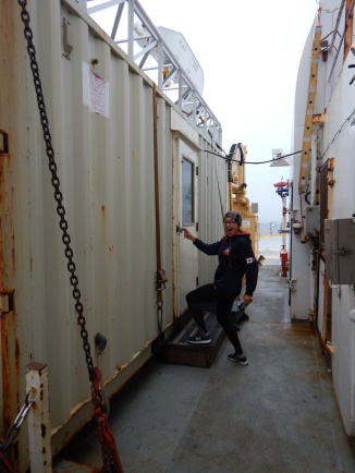 Getting supplies from one of the containers, or vans, on deck.