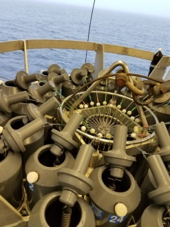 "Top of the CTD rosette (which measures Conductivity (an analog for salinity), Temperature, and Depth (with a pressure sensor). It also has 24 ""niskin"" bottles that can be remotely triggered from the ship to collect water samples. (credit: Kristen Shake)"