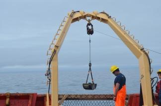 Van Veen Grab sampler coming back with a sediment sample.