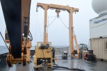 The aft deck of the CCGS John P Tully. The kevlar winch is on the left while the trace metal clean processing container is on the right. Standard water sampling (for oxygen, nutrients, temperature, and salinity measurements) are done with a CTD rosette on the starboard (right) side of the ship.